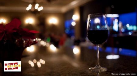Glass of wine with Xmas festivities.